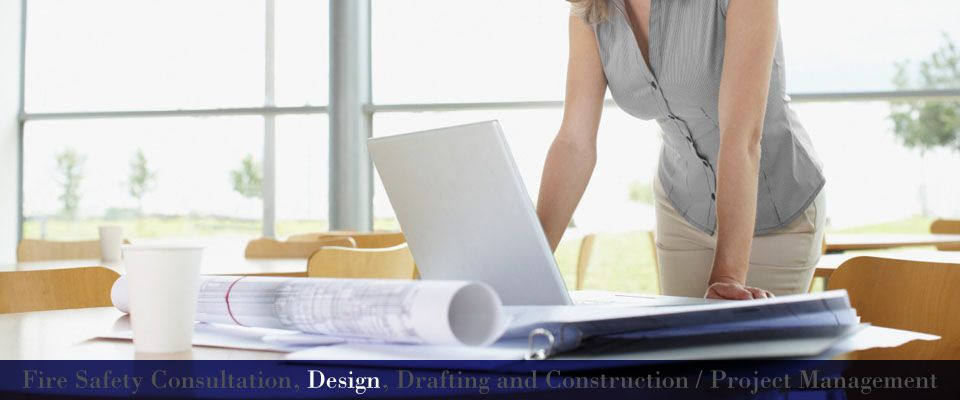 Fire Safety Consultation, Design, Drafting and Construction / Project Management | Designer at desk