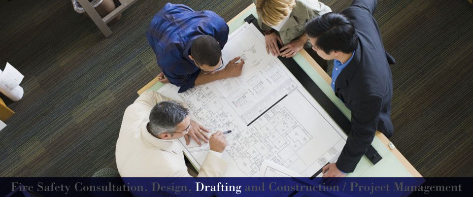 Fire Safety Consultation, Design, Drafting and Construction / Project Management | Engineers working on plans